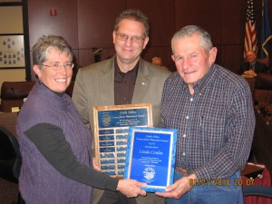 Linda Conlin is presented with the 2010 Andy Aldax award by CWSD Chairman Doug Johnson and Andy Aldax.